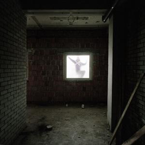 Man fitting a window at the Borovo Naselje sports centre. © Colin Dutton