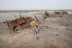 Rustam Ahmed (age 70) is a villager of Patharghata who has lost his land by river erosion. Barguna, Bangladesh