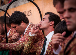 Forcados of the group of Évora preform a small blessing before their group enters the arena. Forcados are extremely religious. © Eduardo Leal