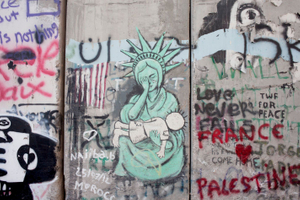 "A painting on the seggregation Wall between Palestinian and Israeli Territories, Bethlehem.   - ""It's really like jail. You can't go out whenever you want. And you cant see... like your friends anytime that you want. Its really like a jail. """