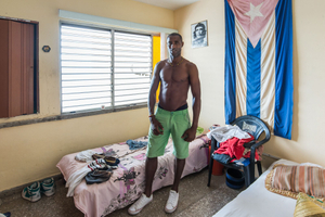 A man introduced his family and home to me in Vedado, Cuba.