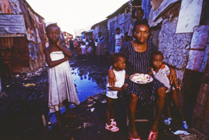 TB infected mother and her children in Cite Soleil, Port-au-Prince, Haiti