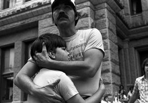 Vietnam Veterans Day in Texas. Dan Jordan, 36, Vietnam War veteran, and his son Chad Jordan, 10, after a speech about Agent Orange outside the Texas State Capital, Austin, Texas, 1981 © Wendy Watriss