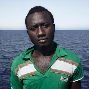 Mediterranean Sea, 1 August 2016. Enssa (17), from Senegal, poses for a portrait minutes after being rescued on the Mediterranean Sea, 20 nautical miles off the Libyan coast by a rescue vessel provided by the NGO Jugend Rettet. The rubber boat in which he travelled carried 118 people on board, who were transferred by the Italian Coast Guard to Lampedusa (Italy).