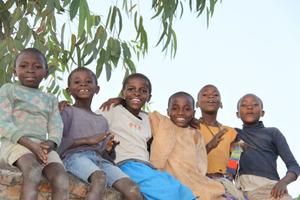 Children sitting on a wall - Musanze Rwanda