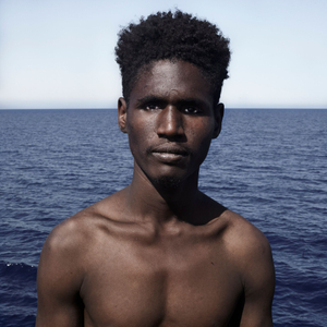 Mediterranean Sea, 1 August 2016. Bubacarr (19), from Senegal, poses for a portrait minutes after being rescued on the Mediterranean Sea, 20 nautical miles off the Libyan coast by a rescue vessel provided by the NGO Jugend Rettet. The rubber boat in which he travelled carried 118 people on board, who were transferred by the Italian Coast Guard to Lampedusa (Italy).