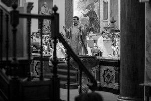 Padre Andrea (Father Andrea Foulco) conducting Mass at St Peter's Italian Church.