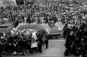 August 28, 1971 - Oakland, California, USA: Black Panthers carry George Jackson's coffin into St. Augustine's Church for his funeral service as a huge crowd watches. In 1961, George Jackson was convicted of armed robbery (as a teenager stealing $70 at gunpoint from a gas station) and sentenced to serve one year to life in prison.