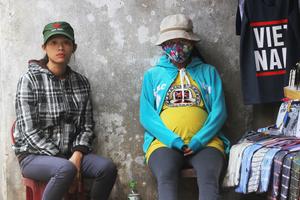 Young street vendors - Hoi An, Vietnam