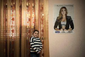 Elena Alvetta, 8 years old, poses inside her room. She is a great fan of Emiliana Cantone.