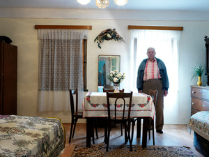 Man in his dining room, Daia 2015