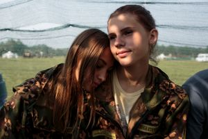 "Nastya Gobritskaya (L, 15) from Moscow and Alina Klikova (R, 16) from Medin at the Historical-War Camp, in Borodino, Russia. 26 July 2016. The project statement of the camp says: ""To awaken in the younger generation a keen interest in the history of the Fatherland, the glorious deeds of our ancestors, to facilitate the expansion of military-historical knowledge."""