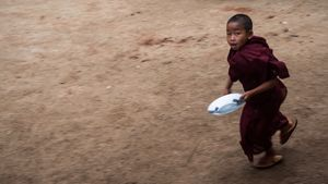 Little monk running for breakfast time