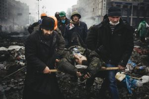 Injured and killed by snipers were carried out under fire to field hospitals to provide medical assistance. Kiev, Feb. 20, 2014.