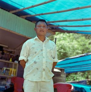 """Aungduba Daju at his car wash, from the series """"Homebodies""""."""