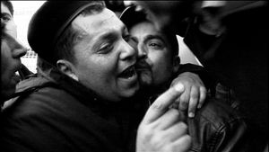 Tunis, Tunisia (2011). A policeman, who just decided to join protesters, is hugged and kissed by the crowd.