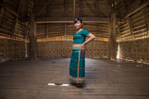 To Dra young lady inside the communal house in Kon Tum Province