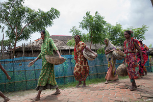 Women going back to their home after a day long work in Shyamnagar, Satkhira, Bangladesh