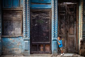 Boy Hiding in Doorway, Havana, Cuba, 2011