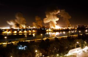 An explosion rocks a building in Saddam Hussein's palace complex in Baghdad, March 21, 2003, during the American 'Shock and Awe' air raids that marked the beginning of the occupation of Iraq. The complex on the banks of the Tigris later became what is now known as the Green Zone and houses both the Iraqi legislation as well as key American installations. © Franco Pagetti, VII