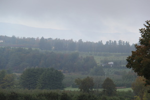 Early autumn mist rising in Vermont's  agricultural Addison County.