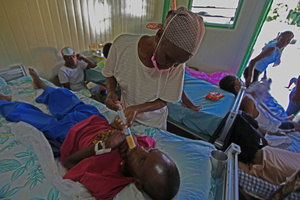 Force feeding a starving TB patient