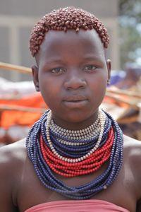 Karo woman wandering the stalls on market day