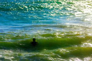 Man bathing in the ocean