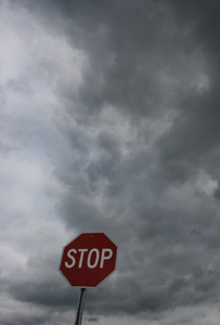 STOP sign under stormy skies