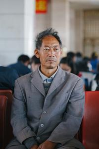 Man at bus terminal. China