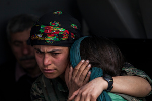 During a ceremony in Kobane, Syria, on 2 April, 2015, mourners gather by the coffin of their loved ones who were killed during clashes with the Islamic State in one of the frontlines of Kobane, Syria.