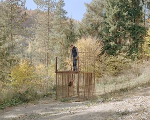 Chief Ranger Bogdan assessing the bear cage on the outskirts of Rucar Village.