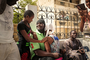 Dakar, April 10, 2015. Superstar Balla Gaye 2 comforts his fans on the terrace of his house in Guédiawaye, after he lost a big fight against his opponent Emeu Sene on April the 5th. His followers praise his friendly, open kind, while his opponents accuse him that he gained an unnatural amount of muscles and weight during his training in the USA.