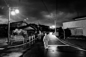 """Animal activist in search of abandoned animals in Odaka city, from the series Fukushima """"No Go"""" Zone, © Pierpaolo Mittica."""