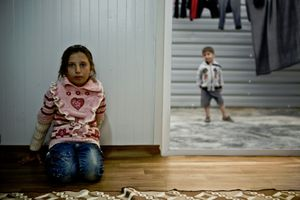 Two children posing in their container home. © Tom Verbruggen