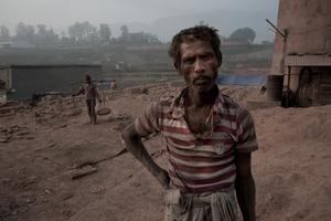 Brick Factory worker, standing