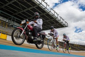 Edwin Matiz, 23, in the middle, chances a motorbike during one of his training sessions at Salitre Sports Complex, Bogotá, June 2016. Paralympics Cyclists chase the motorbike in order to improve their times on the racetrack.