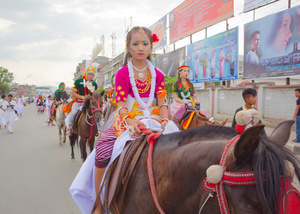 A girl rides a Manipuri polo pony during a Lai Haraoba procession.