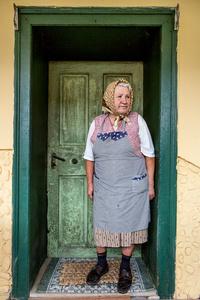 Mrs Hudea, standing in the doorway to her kitchen, Mosna 2015