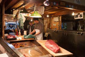 Showcasing tuna at Tsukiji fish market in Tokyo