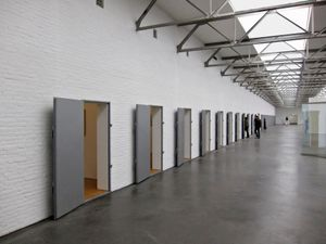De Pont (Tilburg NL) is a former wool spinning-mill. After a thorough refurbishment it reopened in 1992 as a museum for modern art. The line of doors gives entry to the former wool chambers now in use for the exhibition of small works of art.