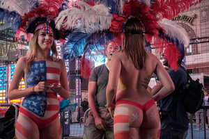 Concerns over aggressive tip seekers became a even more os an issue when topless women wearing body paint, known as desnudas, joined the costumed characters at Times Square.