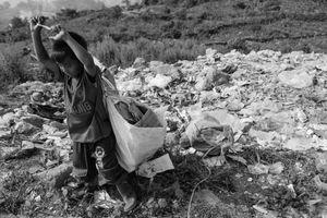 Boy Collecting Trash