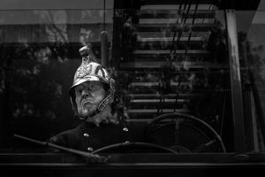 Re-enactor in an old fire engine