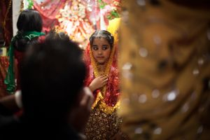 Little girl dressed like the goddess Radha poses in front of the cameras during Krishna Janmashtami celebration at the Kalimandir Hindu Temple in Casal Lumbroso, northern Rome.