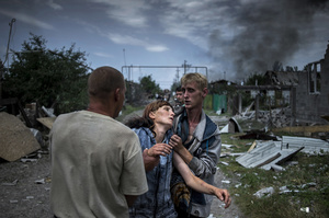 A citizens in the village of Luhanskaya after the air attack