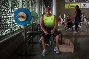 Joe Gonzalez Bettencourt, 38, tries to relax after some weight lifting exercises in the gymnasium at Atanasio Girardot Stadium, Medellin, March 2016.