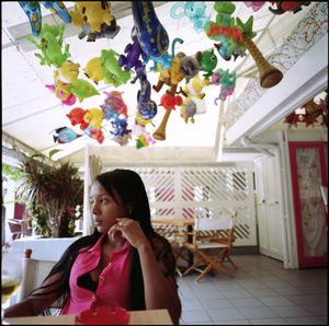 Sahomy, her daughter back home with her parents, in the first month of a six-month work contract in St. Maarten