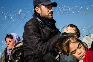 December 2016, Idomeni, Greece. A family of Jezidi's from Iraq waits for hours at the Greek Macedonian border. As Macedonia closed its border for all refugees except Syrians, Afghans and Iraqi's, they control every document toroughly.