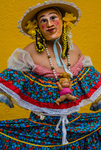 Zayaca with Baby Doll Necklace During Carnaval
